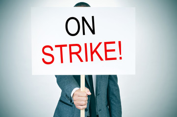 young man in suit on strike