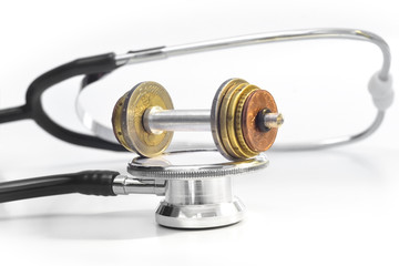 MEDICAL EXPENSES 3 - A stethoscope & a coin-weight-lift on top.