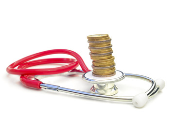 MEDICAL EXPENSES 4 - A stethoscope with a pile of coins on top.