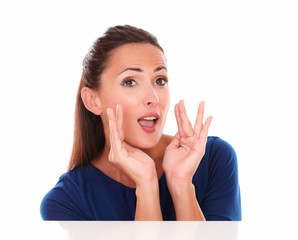 Cheerful lady in blue shirt gesturing screaming