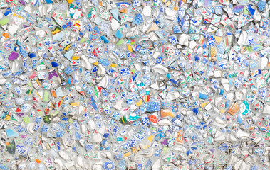 The background image from splinters of a ceramic tile on a wall