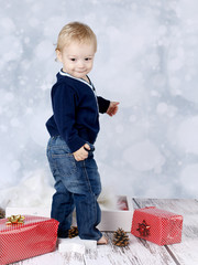 Little baby boy with christmas presents