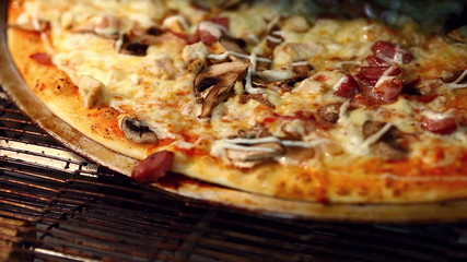 Traditional Italian pizza baking in oven