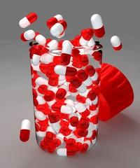 Aspirine pillole versate su un piano e contenitore con tappo