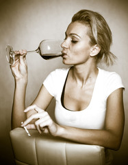 Drunk woman with glass of wine