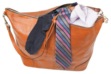 leather handbag with shirt, tie, sock isolated