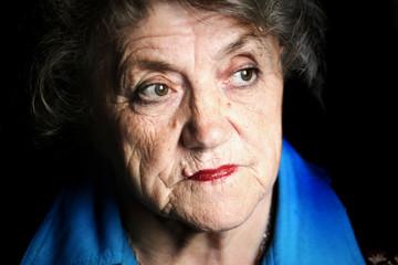 A portrait of a sad granny