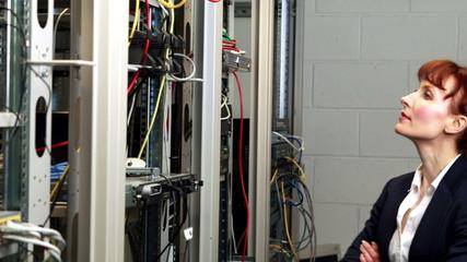 Technician looking at open server locker