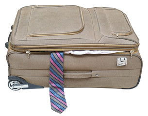 textile suitcase with fell out tie isolated