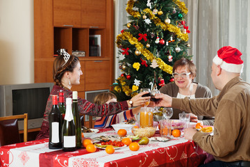 family of three generations  celebrating Christmas