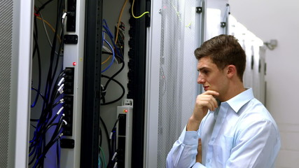 Technician looking at open server locker