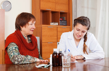 doctor prescribing medication to senior woman