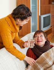Adult daughter caring for sick mother has cold