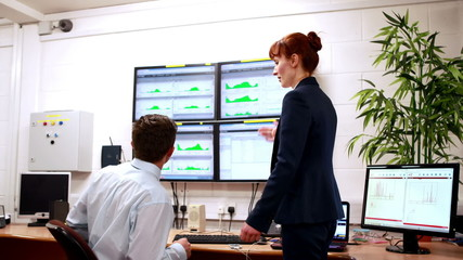 Data center colleagues talking in office