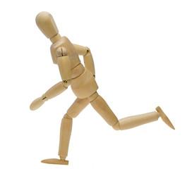 走るポーズする木製人形