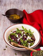 Beetroot salad with arugula, feta cheese and pumpkin seeds