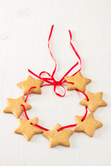 Christmas stars cookies on white wooden background