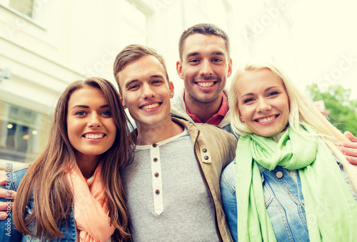 canvas print picture group of smiling friends in city