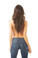 Full length shirtless woman alluring in jeans