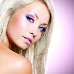 Portrait of the beautiful blond woman with pink makeup
