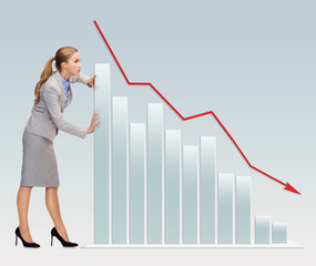 busy businesswoman pushing graph falling down