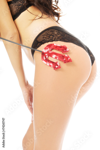 canvas print picture Close up on female buttocks and devil's trident