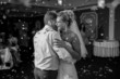 monochrome portrait of dancing at restaurant bride and groom