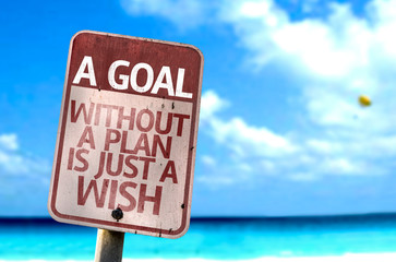 A Goal Without a Plan Is Just A Wish sign with a beach