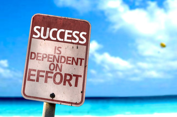 Success is Dependent on Effort sign with a beach