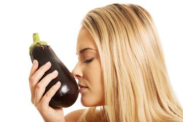 Portrait of a woman smelling eggplant