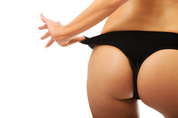 Close up on woman slim buttocks in black panties