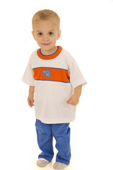 Two year old boy in sportswear outfit standing