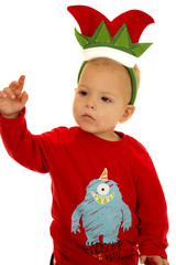 Young boy wearing pajamas and Christmas elf hat