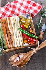 Fettuccine over rustic wooden background