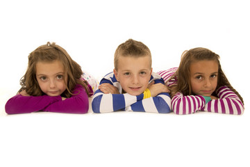 Children laying down in pajamas happy and smiling