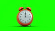 Alarm clock ringing on green background
