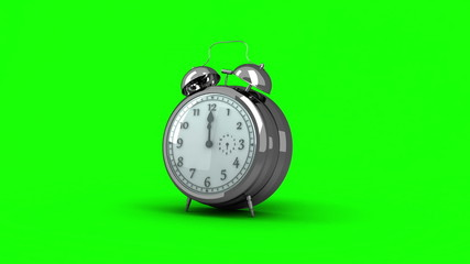 Alarm clock ringing on green background