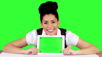 Pretty woman showing tablet with green screen