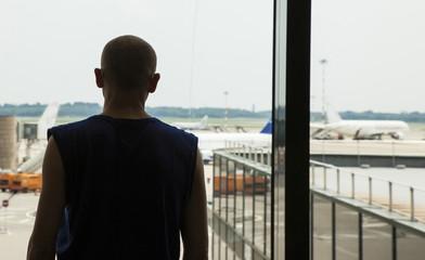 Man waits at the airport