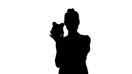 Woman shaking piggy bank in black silhouette