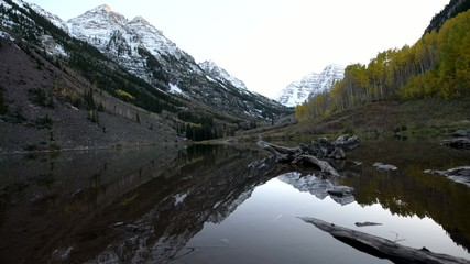 Maroon Bells and its Reflection in the Lake with Fall foliage in