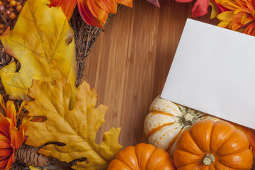 Colorful autumn leaves and pumpkins