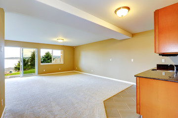 Spacious family room with kitchen cabinets.