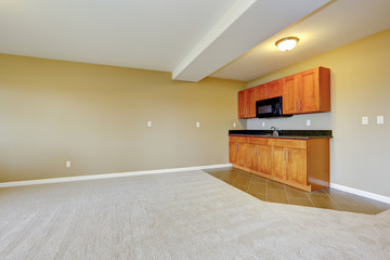 Spacious dining area with kitchen cabinets.