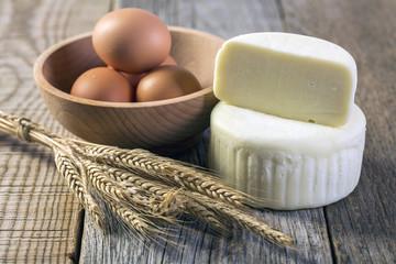 Cheese, eggs and wheat ears .