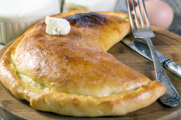 Khachapuri with a piece of butter.