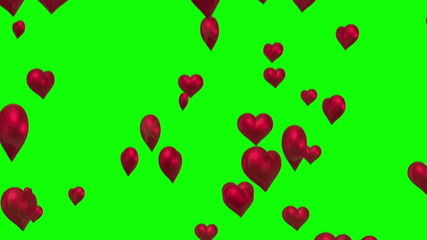 Red hearts floating against green screen