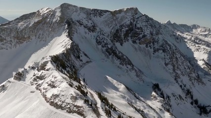 Aerial of Snow on Mountain Ridge