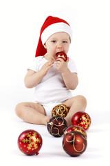 Little Santa toddler tasting christmas ball