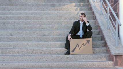 Businessman Sits On Steps Economic Arrow